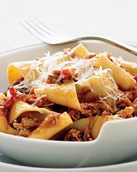 Pappardelle with Milk-Roasted Baby Goat Ragù | This is a signature dish at Komi, where Johnny Monis slowly roasts the baby goat in milk until it's meltingly tender, then simmers it in tomato sauce before spooning it over fresh, eggy pappardelle noodles.