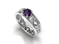 Filigree engagement ring with purple iolite and diamonds, made from white gold by TorkkeliJewellery, $1790.00