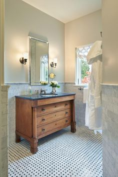 HGTV invites you to step inside this traditional bathroom with black and white basket weave tile floors and a marble tile backsplash.