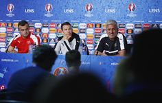 Head Coach Vladimir Petkovic (R) of Switzerland talks to the media as players Xherdan Shaqiri (L) and Stephan Lichtsteiner listen during the Switzerland Press Conference at the Stade Bollaert-Delelis on June 10, 2016 in Lens, France.
