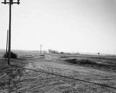 Looking toward the mountains in smog, Weld County, Colorado, 1983