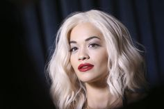 FILE - In this Nov. 10, 2013 file photo, Rita Ora poses for photographers backstage at the 2013 MTV Europe Music Awards, in Amsterdam, Netherlands. Ora fainted during a photo shoot for Madonna's Material Girl clothing line Monday, Nov. 18, 2013, in Miami. She was treated for heat exhaustion and dehydration and released. (Photo by Joel Ryan/Invision/AP, File)