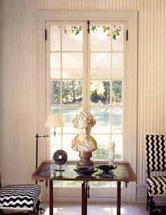 French bi-fold door // bust // short floor lamp //chevron chair + ottoman // tray table // objects