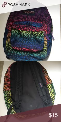 Jansport animal print backpack b2s Jansport Rainbow Animal print backpack. Great for back to school. Zippers in working condition, no holes or rips. Light wear--some light stains on the interior and back and some ink stains in front pocket. Jansport Bags Backpacks