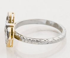 Here at our store, we do love a bow/ribbon...in any shape or size. We think its so romantic! We took the center portion of a fabulous antique bar pin and put it together (with a little help from our master goldsmith!) with the perfect wedding band from the 1920s. The result is this totally one of a kind gorgeous shimmering Art Deco ring filled with sparkly diamonds and square sapphires. In two tone, this ring looks dynamite on the hand. She will adore it!  Antique Ring - Antique Art Deco...