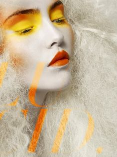 I absolutely LOVE this high-fashion yellow & orange makeup look. It feels very citrus-inspired... and although it's totally unwearable, I really want to find a way to make it work