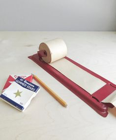 We had this by the kitchen phone when i was a kid... paper roll memo pad / note pad / list maker on Etsy, $32.00