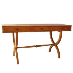 1930s sycamore console / desk    1930s sycamore console / desk  UK  1930's  sycamore writing table believed to have been designed in 1935 by architect R. W. Aldridge for Lady Ilife  Measurements  height: 30.31 in. (77 cm)  depth: 21.65 in. (55 cm)  width/length: 5 ft. 0.2 in. (153 cm)  Location  bent ply  95 Lisson Grove  London, UK, NW1 6UP	  Phone: 447711940931	  E-Mail: bruna@bentply.com
