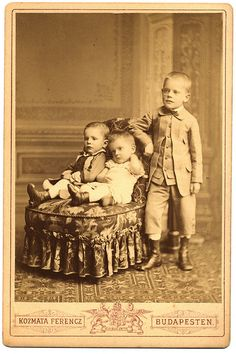 victorian children..so serious! The one standing is post mortem