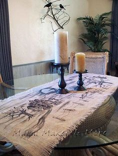 Great table runner that will start a conversation at the table for sure.  Burlap, black , sharpie and black paint..thats it.. they forgot some artistic skills!~~~