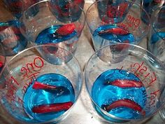 Website with links to Dr Seuss inspired snacks.  As for the blue jellow with fishes....how about some sort of blue drink instead with swedish fish in it?