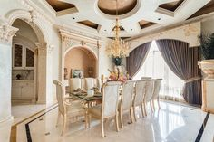 Traditional Dining Room with Built-in bookshelf, Chandelier, limestone tile…