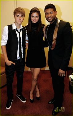 Justin, Selena, and Usher. Selena always looks so cute!!
