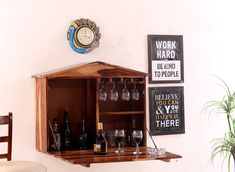 "Sheesham Wood Wine Storage Ora Stylish ""Hansvon Wine Rack"" for your Living Room! Beautifully crafted from fine quality Sheesham wood, this bar cabinet adds a touch of elegant charm to your home. Teak, Wooden Street, Wine Storage, Bar Furniture, Wooden Shelves, Wine Rack, Crates, Liquor Cabinet, Room Decor"