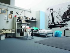 http://www.justsoakit.com/wp-content/uploads/2015/01/iinteresting-bedroom-design-for-boys-with-music-scheme-wallpaper-as-well-gry-rug-on-floor-including-wardrobe-corner-and-book-shelves-idea-on-the-wall-above-bed-and-study-table-beside-bed-970x728.jpg