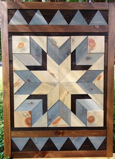 This piece uses a diamond shape stained in shades of blue-gray. It is a combination of cedar and pine, and is x Reclaimed Wood Wall Art, Rustic Wood Walls, Wooden Wall Art, Wood Art, Wood Block Crafts, Wood Crafts, Wood Projects, Barn Quilt Designs, Barn Quilt Patterns