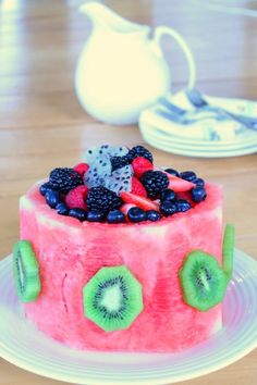 Healthy and pretty watermelon cake! This cake made from fruit is perfect for birthday parties, holidays, or a special dinner. Plus the kids won't be crazy on sugar!