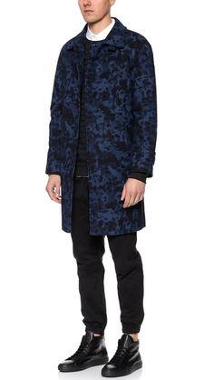 Major coat envy from Soulland. Navy camo trench coat!
