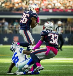 New England Patriots cornerback Logan Ryan (26) intercepts a pass intended for Dallas Cowboys wide receiver Vince Mayle (85) as free safety Devin McCourty (32) looks on during the second half of an NFL football game at AT&T Stadium on Sunday, Oct. 11, 2015, in Arlington. (Smiley N. Pool/The Dallas Morning News)