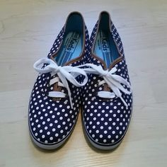 Navy Polka-dot Keds 7.5 Cute navy, polka-dot Keds with leather detail in size 7.5. These have been worn only a few times and are in excellent, pre-loved condition. Great casual shoe! keds Shoes Sneakers
