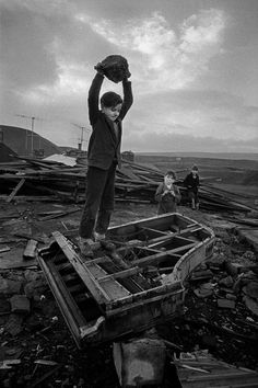 Boy destroying Piano, Wales, 1961.    photo by Philip Jones Griffiths