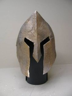 Spartan Helmet paper mache.  This site also has leg guards and wrist bands for Spartan gear.