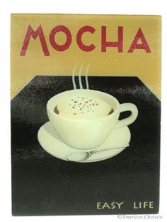 """Tempered Glass Mocha Coffee Bistro Cutting Board by American Chateau. $11.99. Odor & Stain Free. Mocha Glass Cutting Board. Hygienic Work Surface. 16"""" x 12"""". Tempered Heat-resistant Glass. This beautiful tempered glass cutting board depicts a smoking warm mocha cup. The board reads EASY LIFE in the bottom corner and would make a great addition to any coffee themed or French bistro kitchen. The cutting board is incredibly utilitarian and can be used as a trivet (eve..."""