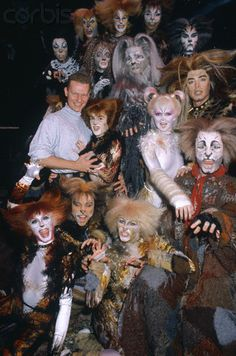 The cast of the musical Cats decked out in all their furry feline finery, pose with their director, John Yost, during their Paris season at the Theatre de Paris. 1989