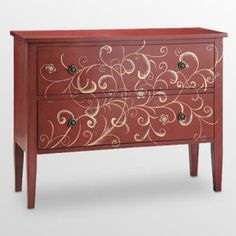 Red painted chest with swirl design. Awesome.