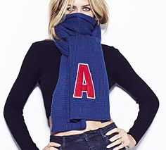 Cheap and chic: If you can't afford a Burberry scarf, Matalan has unveiled a range of monogrammed scarves for just £10, as modelled by Abbey Clancy. The best part? All profits go to Alder Hey Children's Hospital