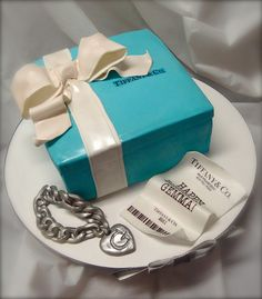 What a cute cake idea, especially if you really give the charm bracelet as a gift!