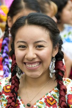 Teotitlán del Valle, Oaxaca, México. Young zapotec smiling woman. Photo by Christopher Stowens.