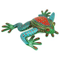 Javier & Maria Soledad Jimenezcreated this elegant frog sculpture. The figure has a very nice sense of movement and is beautifully painted.