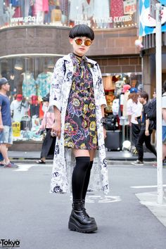15-year-old Moeka on the street in Harajuku wearing a long Kobinai jacket over a resale dress, Demonia platforms from Never Mind the XU Harajuku, and a Glad News backpack.