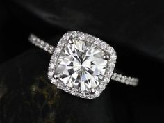 cushion cut engagement ring with halo and pave band.