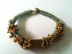 Seed Bead Rope Bracelet Gold & Green.  Bead woven by Jeka Lambert.  Seed beads, vintage bugle beads, metal heishi disks, freshwater pearl.
