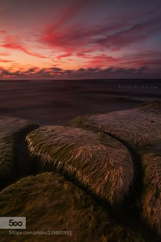 Velvet rocks by andreireinol  baltic beach blue clouds color colors estonia europe landscape light low tide orange red sea seascap