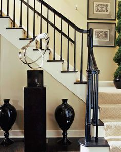 Graceful and graphic artwork create a beautiful entryway - Traditional Home® art Black Stair Railing, Black Stairs, Wood Stairs, Painted Banister, Doors And Floors, Interior And Exterior, Interior Design, Traditional House, Wall Colors