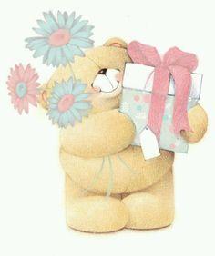 .osito con regalo y flores