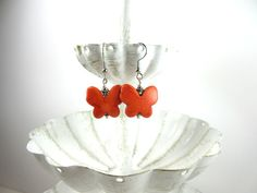 Orange Butterfly Earrings: I made these with adorable stone butterfly charms in a vibrant orange. The stone is orange reconstituted turquoise with