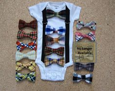 **This listing is for 1 onesie with suspenders and your choice of 1 bow tie **  This stylish set for your little boy includes a onesie with sewn on suspenders and a hand sewn bow tie. Please choose your bow tie in the drop down menu. Ties are attached by sew-on-snaps and can be removed and replaced with another Krafts by Kizzy bow tie to create a new outfit.  Please see our other listing to purchase more bow ties for your bodysuit. https://www.etsy.com/listing/159683071&#x...