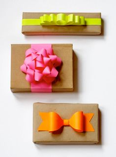 Brown paper bags and neon paper can yield some nice-looking gift packaging. I made these bows with more of the Astrobright Neon paper I men...