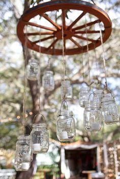 Mason jar wagon wheel chandelier | Wild West Theme Ideas | Pinterest