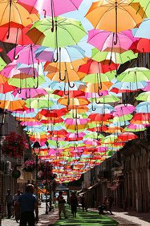 reminds me of Alice in wonderland great party/wedding/shower idea: hanging colorful umbrellas; photographed by Patrícia Almeidagreat party/wedding/shower idea: hanging colorful umbrellas; photographed by Patrícia Almeida Land Art, Street Art, Street View, Umbrella Art, Umbrella Street, Umbrella Cover, Colorful Umbrellas, Parasols, Public Art