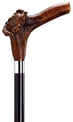 Stag Horn Handle - Natural Cane Imported from Italy, the stag horn handle with simulated brown finish is made of durable high impact molded nylon and mounted stylishly on a black lacquered hardwood sh