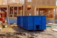 Blur dumpster, recycle waste and garbage bins near new construction site of appartment houses building Royalty Free image photo