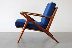 Gorgeous arm frame design- this blue fabric with the wood finish is married so well #chinatownefurniture
