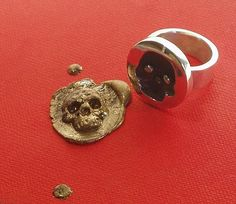wax seal ring. This is so awesome! I have so many cool sealing wax colors that would look so awesome with this! :D