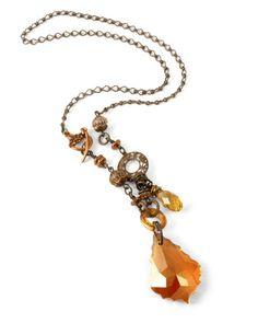 I like the mix of crystals and metal in this.  And the toggle that shows on the side.