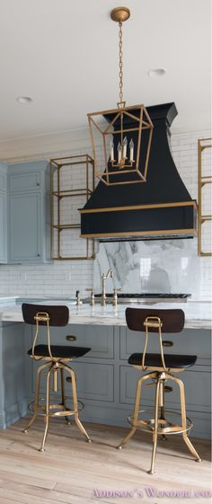 Those chairs, love the use of black with the gold metal